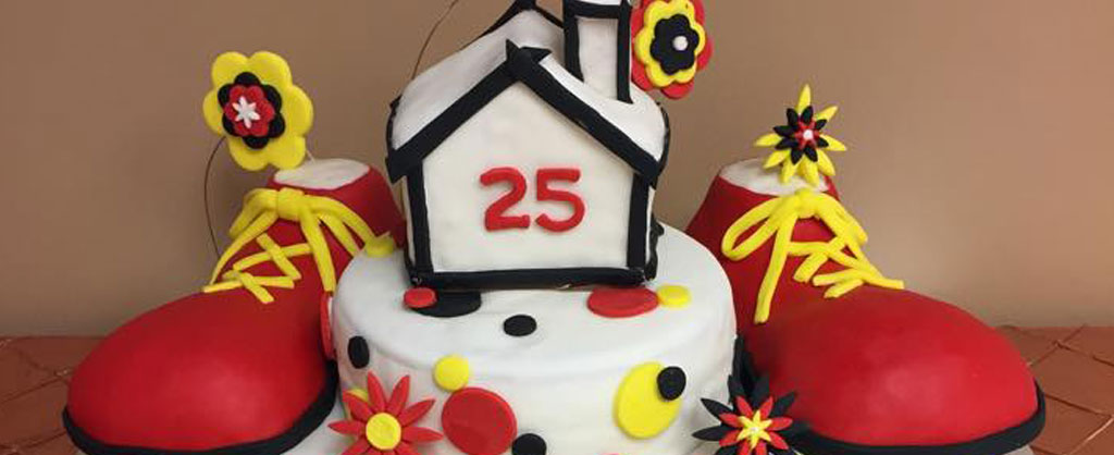 Caker decorated with Ronald McDonald Shoes and a cake House with 25 on it to celebrate 25th Anniversary
