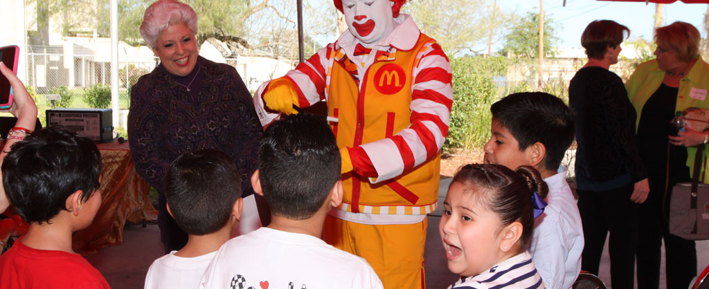 Former Mayor Nelda Martinez and Ronald McDonald entertain a group of children from Ronald McDonald House