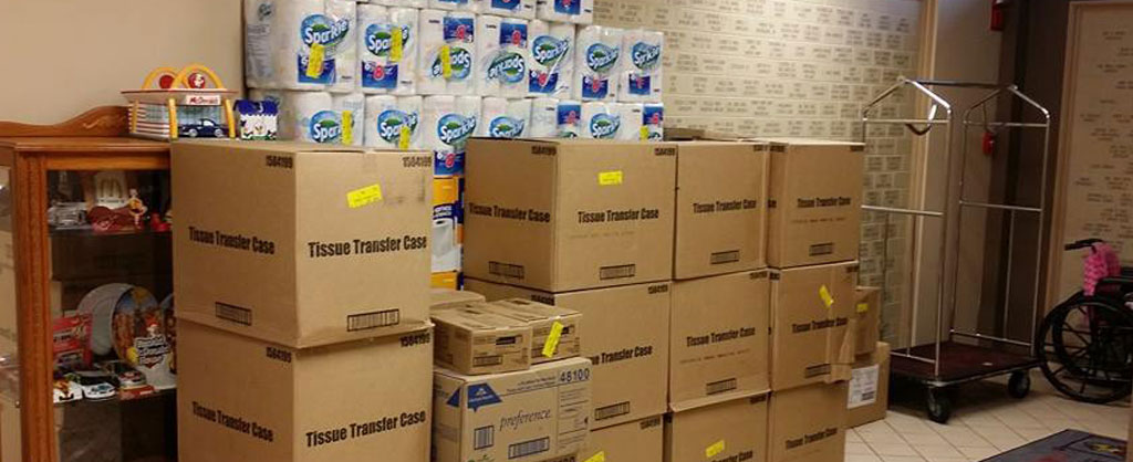 Boxes of donated items like toilet paper and toiletries